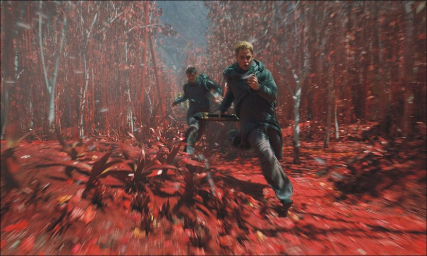 Bones and Kirk run through a red forest.