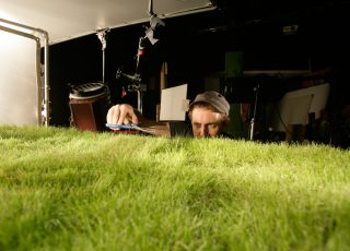 Director Simon Rippengale grooms the purpose-grown grass for the shoot.