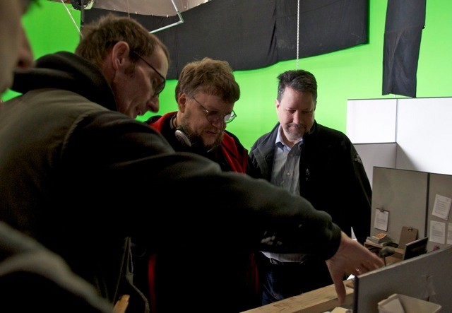 From left: model supervisor Nick Dabo, directorGuillermo del Toro, ILM VFX supervisor John Knoll.