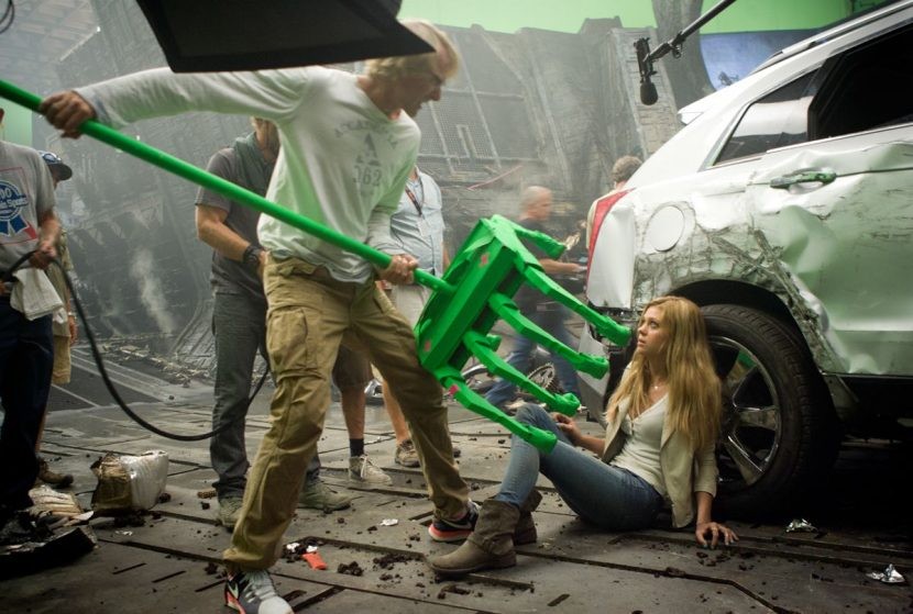 Director Michael Bay and actor Nicola Peltz (Tessa) on the set of Age of Extinction.