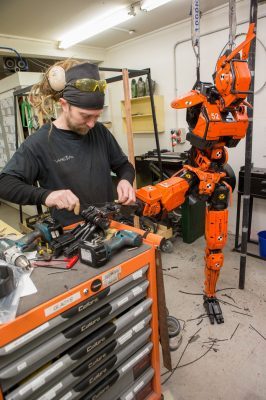 A practical orange prototype droid under construction at Weta Workshop. Photo credit: Steve Unwin.