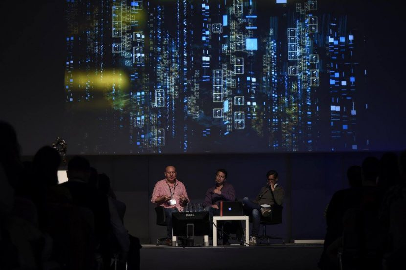 Paul Butterworth (left) discusses Animal Logic's work on the internet visualization at FMX. Photo by Reiner Pfisterer.