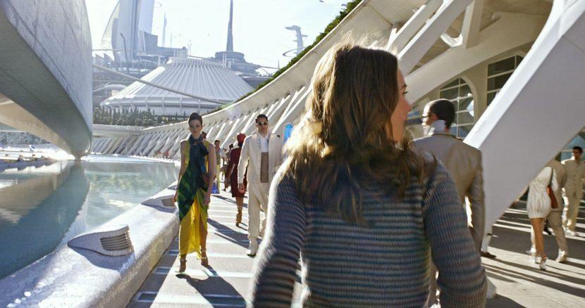 Casey walks around Tomorrowland.