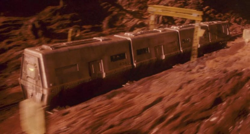 The train marked '43A' travels across the surface of Mars in a dramatic combination of live action projection, miniature landscapes and matte paintings.