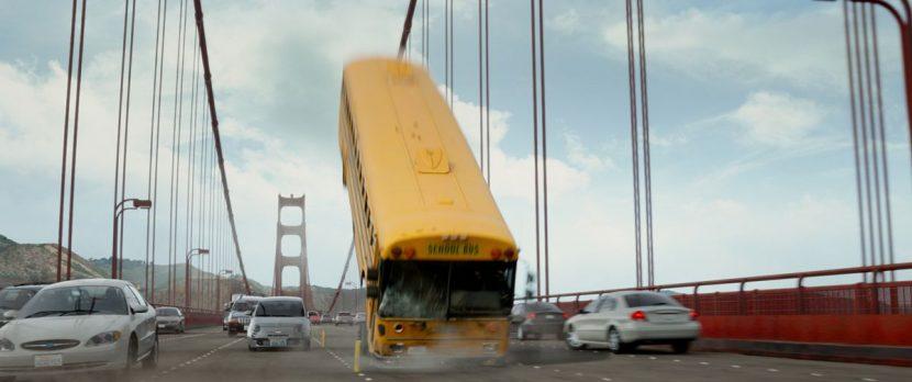 The bus on the Golden Gate Bridge begins to flip.