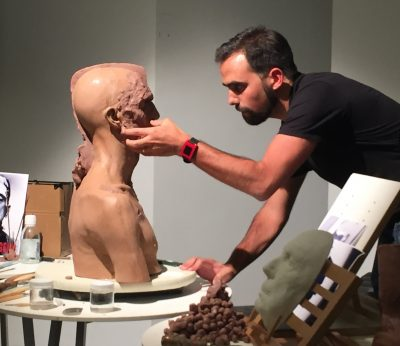 An attendee works on a Frankenstein bust in one of presenter Shane Mahan's (Legacy Effects) workshops at Trojan Horse.
