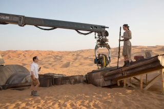 Director J.J. Abrams on set with Daisy Ridley (Rey).