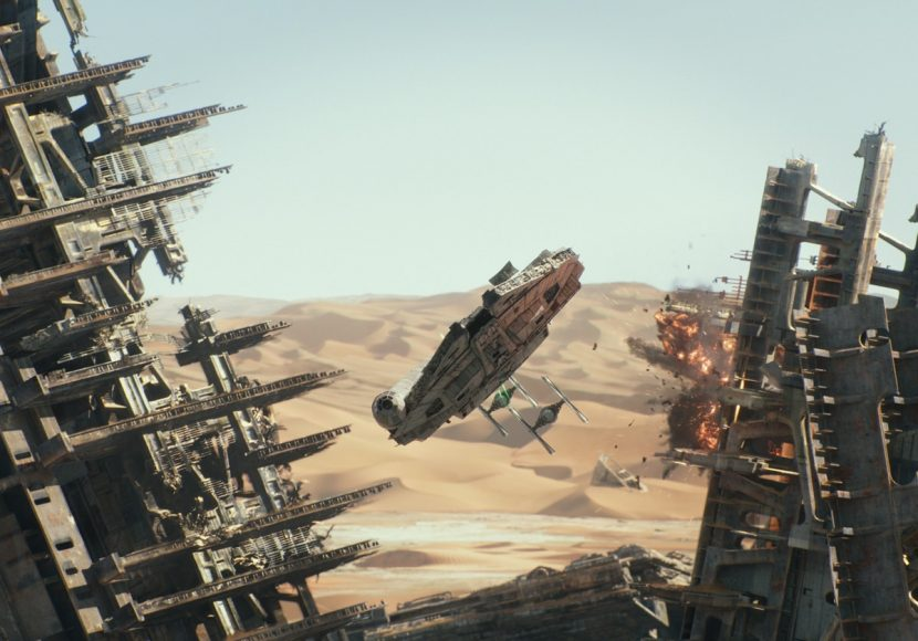 The Falcon evades two Tie Fighters through the ship graveyard.