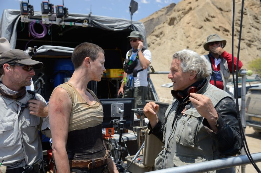 George Miller with Charlize Theron on set.