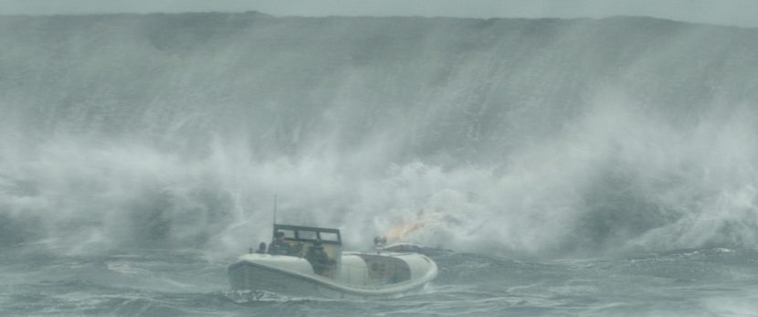 The rescue boat battles to make it out to open waters.